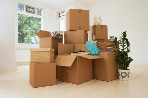 stack-of-moving-boxes-in-new-house
